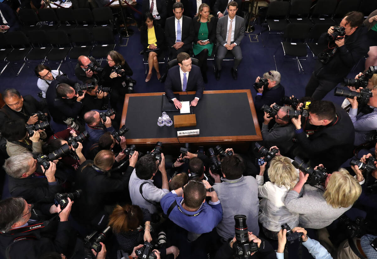 Facebook CEO Mark Zuckerberg arrives to testify before a joint hearing of the Commerce and Judi ...