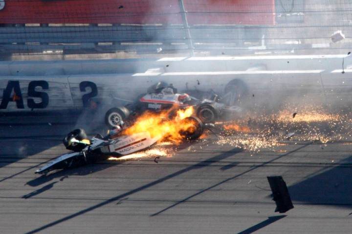 Dan Wheldon, front left, and another driver crash during a wreck that involved 15 cars during t ...