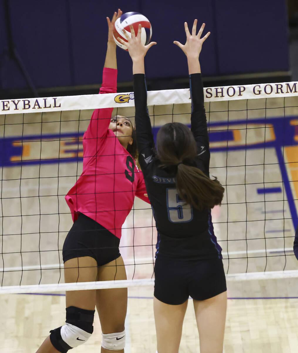 Bishop Gorman's outside hitter Imani Dambreville (9) sends the ball over the net as Silverado's ...