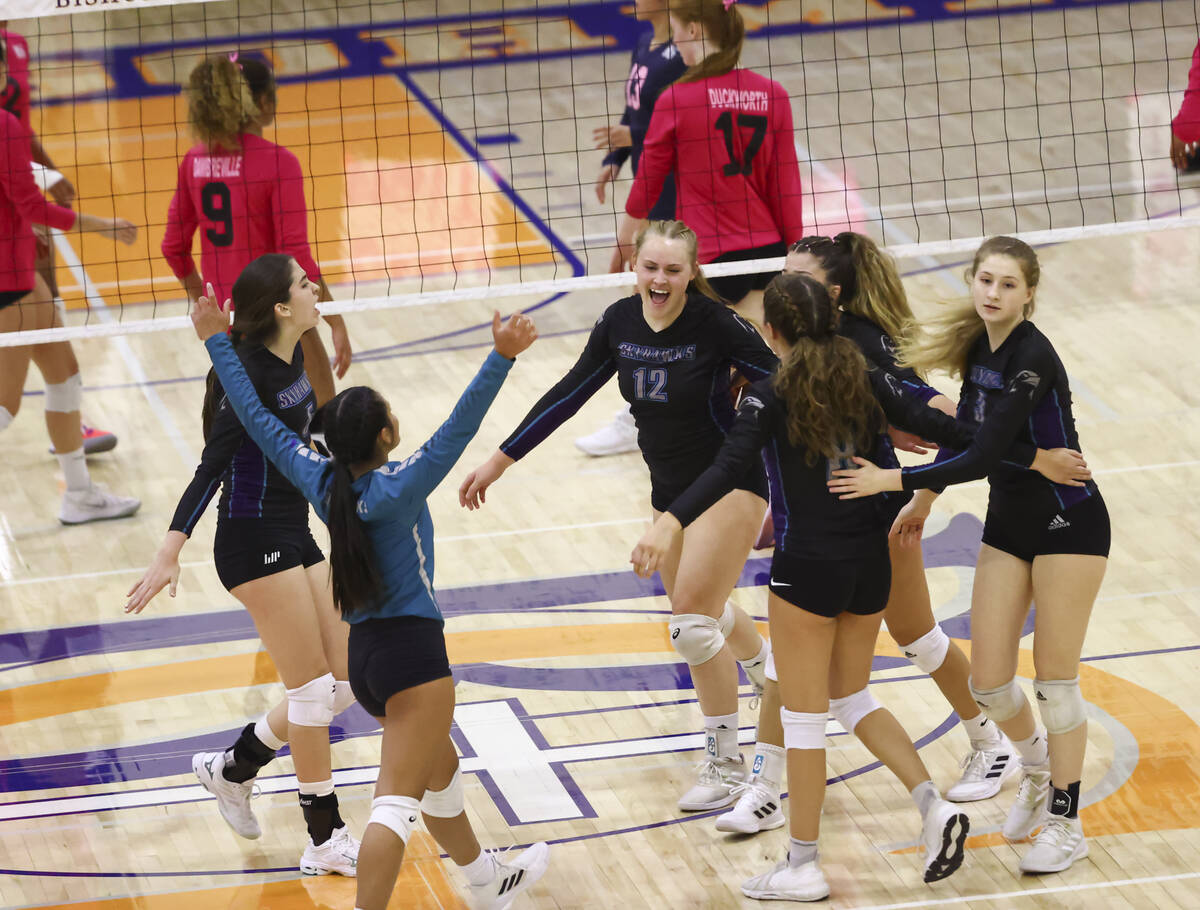 Silverado players celebrate after a play during a volleyball game at Bishop Gorman High School ...