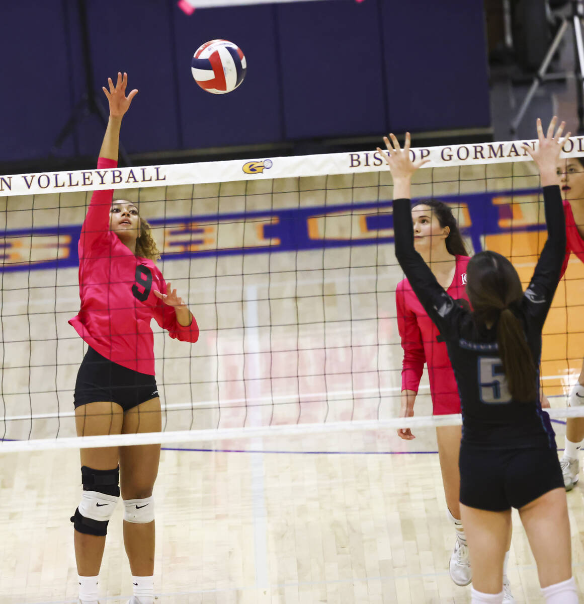 Bishop Gorman's outside hitter Imani Dambreville (9) hits the ball during a volleyball game at ...