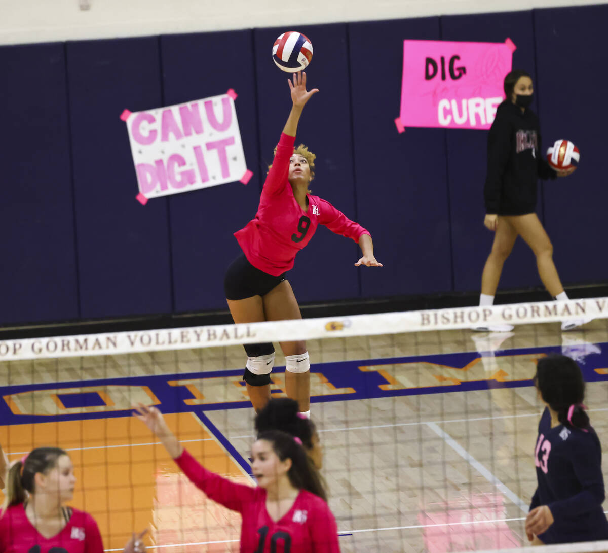 Bishop Gorman's outside hitter Imani Dambreville (9) serves the ball against Silverado during a ...