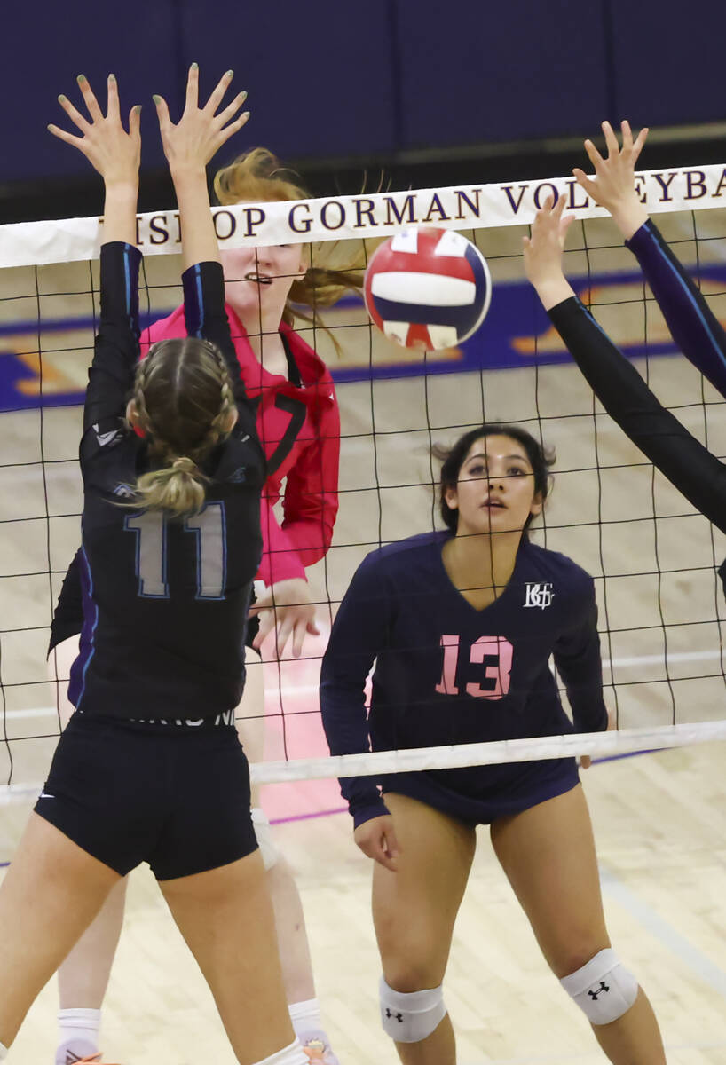Bishop Gorman's middle blocker Ashley Duckworth (17) sends the ball past Silverado's Jenna Dese ...