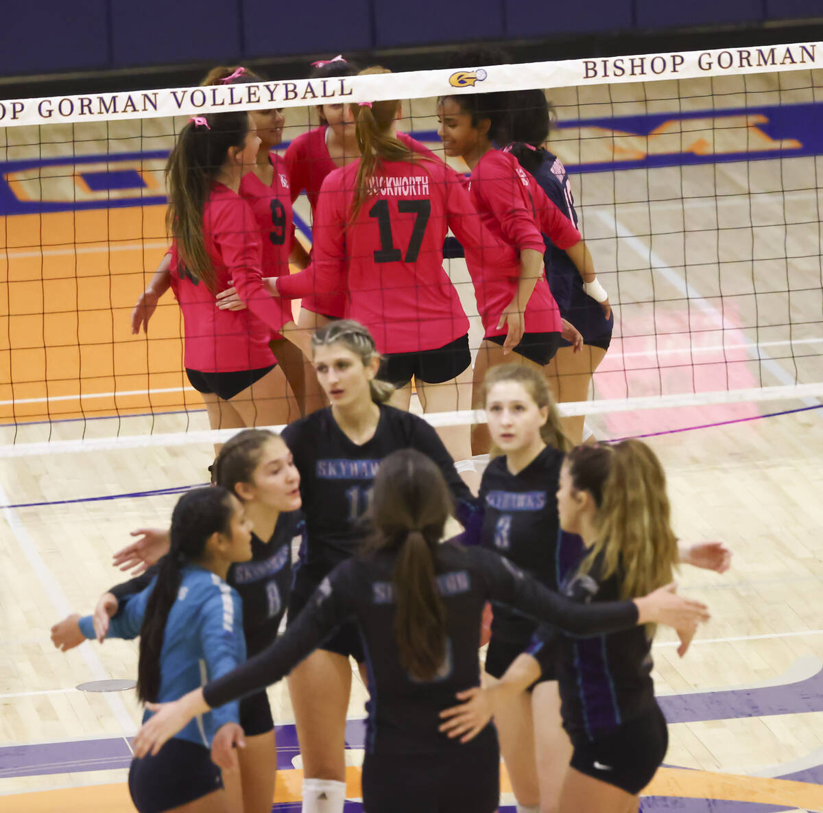Bishop Gorman and Silverado players huddle after a play during a volleyball game at Bishop Gorm ...