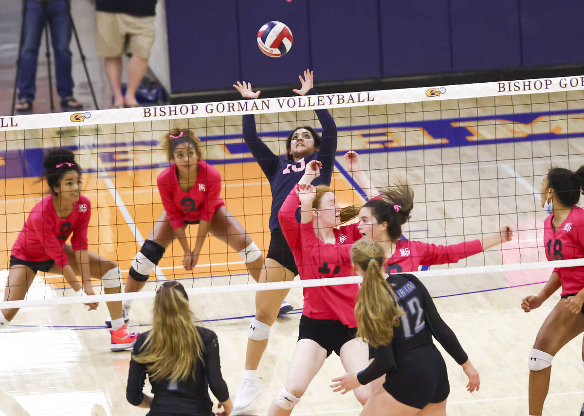 Bishop Gorman's Tatum Thompson (13) hits the ball against Silverado during a volleyball game at ...