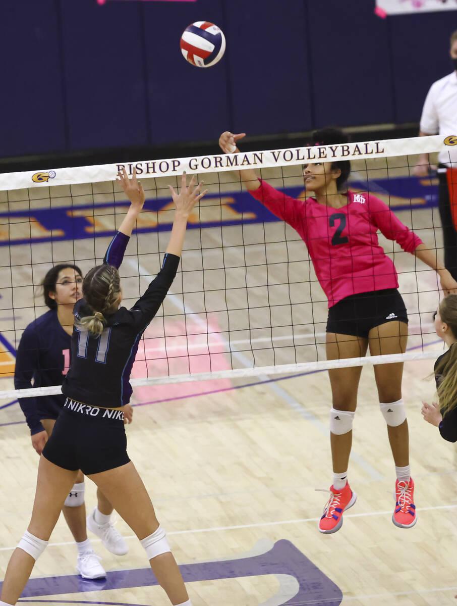 Silverado's Jenna Desellems (11) and Bishop Gorman's Sophia Ewalefo (2) reach for the ball duri ...