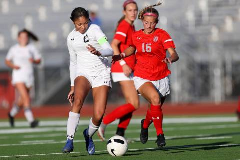 Centennial's Syrena Taylor (13) and Arbor View's Isabella Srodes (16) compete for the ball duri ...