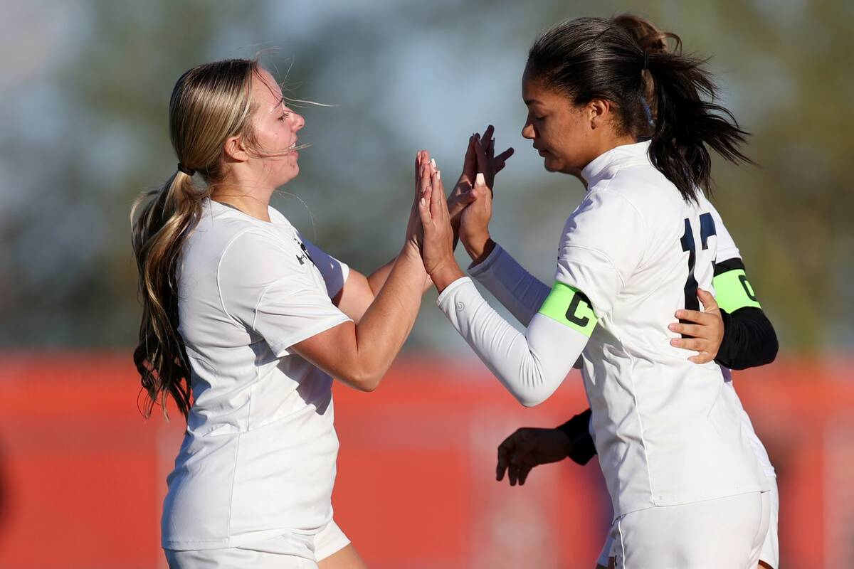 Centennial's Syrena Taylor (13), right, celebrates a goal with Savannah Walers (18) during the ...