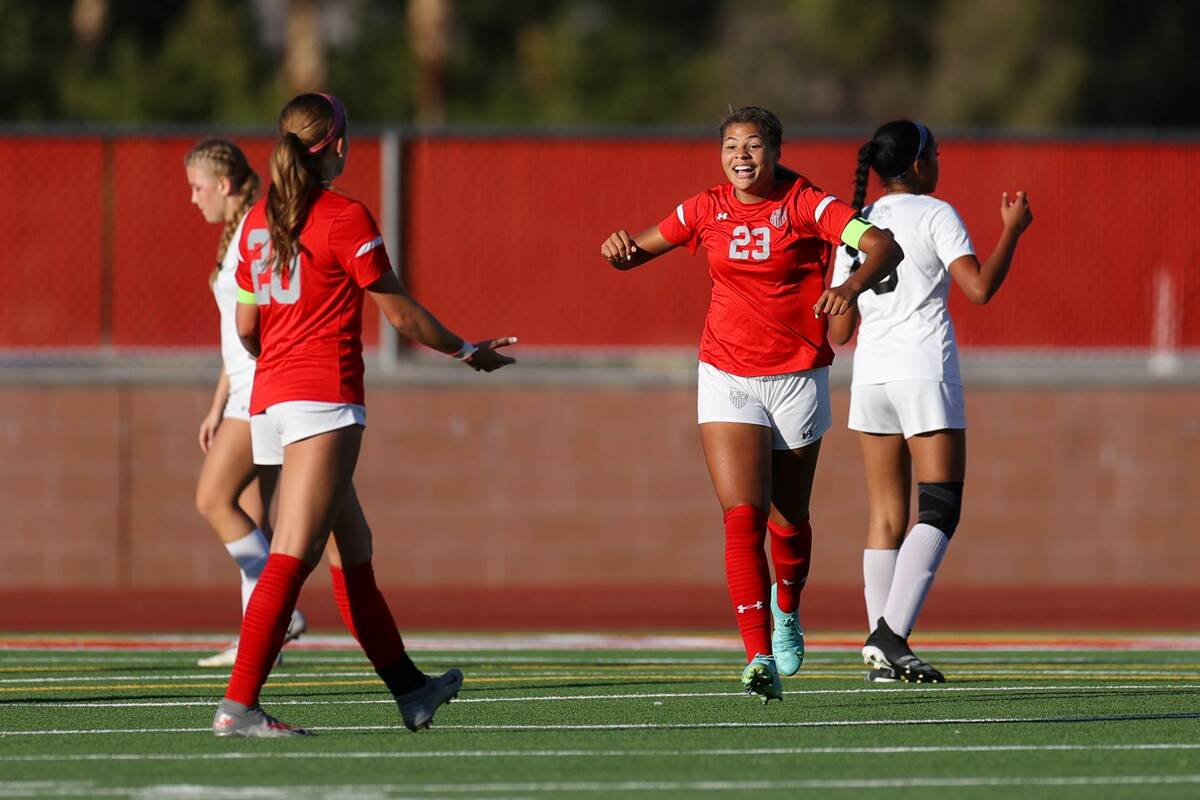 Arbor View's Tiana Beavers (23) reacts after scoring a goal against Centennial during the first ...