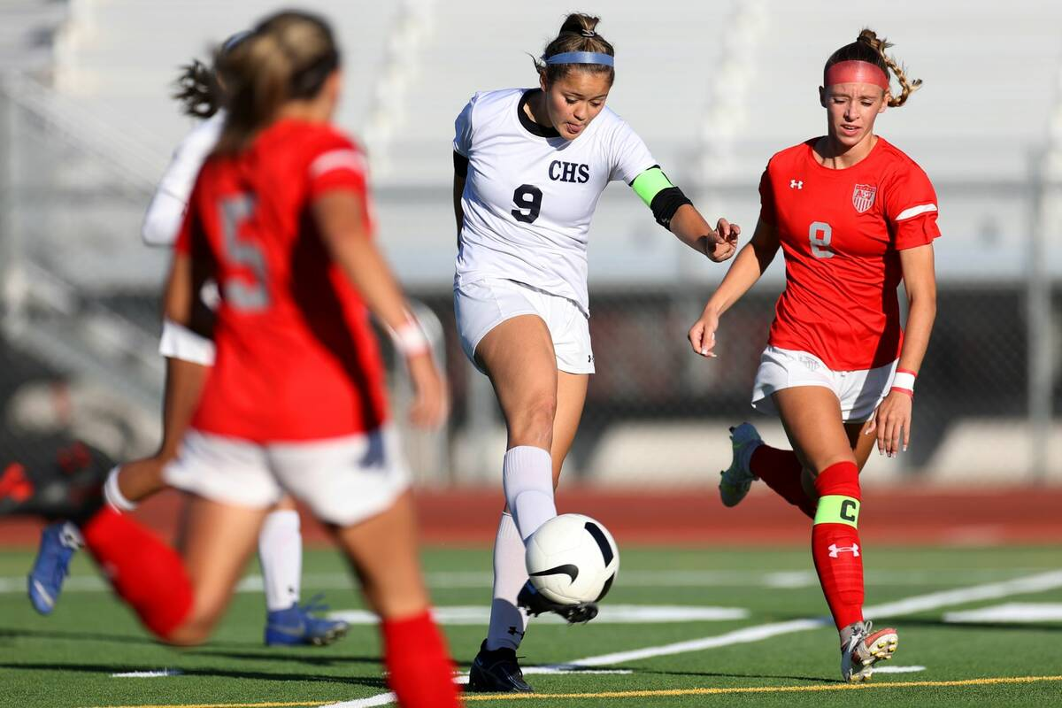 Centennial's Skye Kennedy (9) takes a shot at the goal under pressure from Arbor View's Amy Rey ...