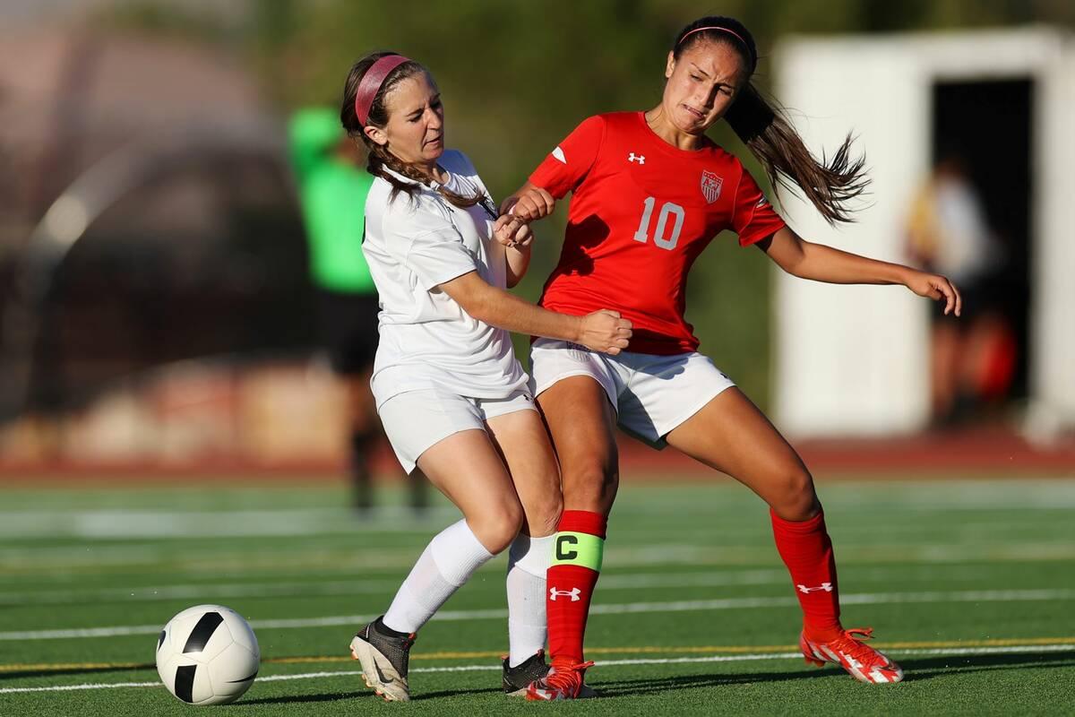 Centennial's Alexandria Neubert (2) loses the ball against Arbor View's Elisa Corvalan (10) dur ...
