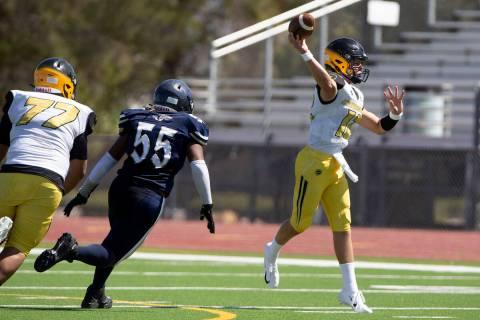 Clark quarterback Mason King (12) passes as Cheyenne defensive lineman Javon Holloway (55) and ...