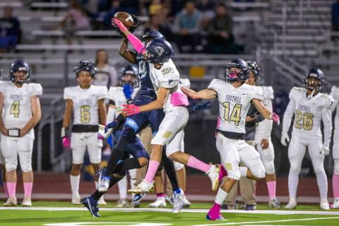 Canyon Springs' Tavian A. McNair (9, left) has a pass knocked away by Foothill's Jason Fisher ( ...