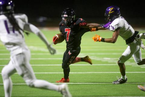 Las Vegas' running back Torrell Harley (7) heads for the end zone as Durango's defensive back J ...