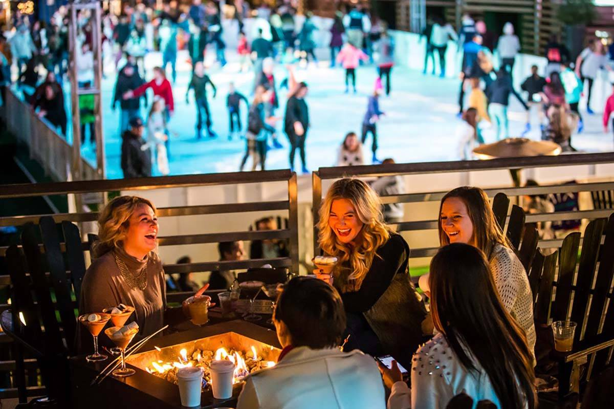 Fire pits are available around the ice skating rink at The Cosmopolitan of Las Vegas, which reo ...