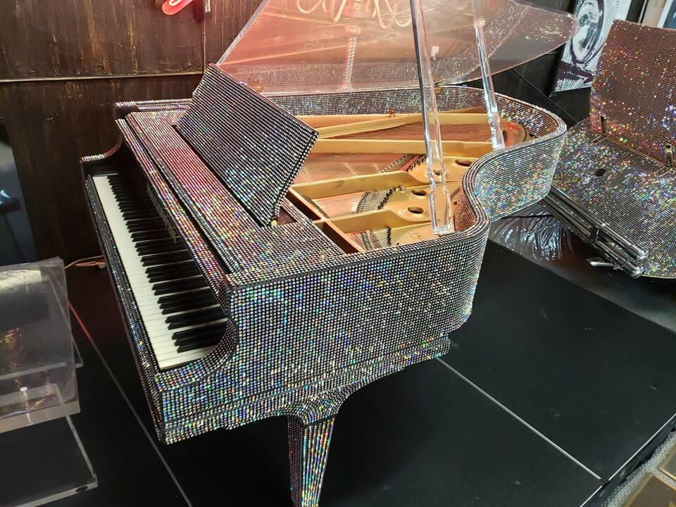 A look at Liberace's 7-foot Baldwin, covered in 80,000 crystals, which was built especially for ...