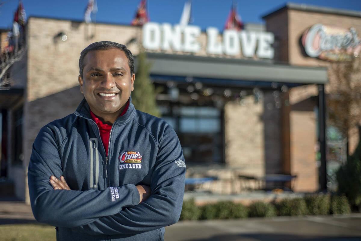 AJ Kumaran, co-CEO and COO, stands outside a Raising Canes restaurant. (Raising Canes)