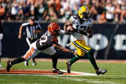 Green Bay Packers wide receiver Davante Adams (17) tries to escape the tackle of Cincinnati Ben ...