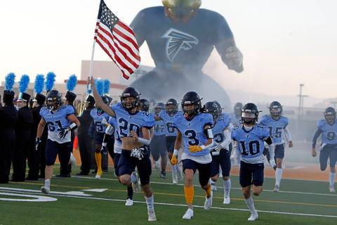 Foothill High School's players run out to the field before a football game against Legacy High ...