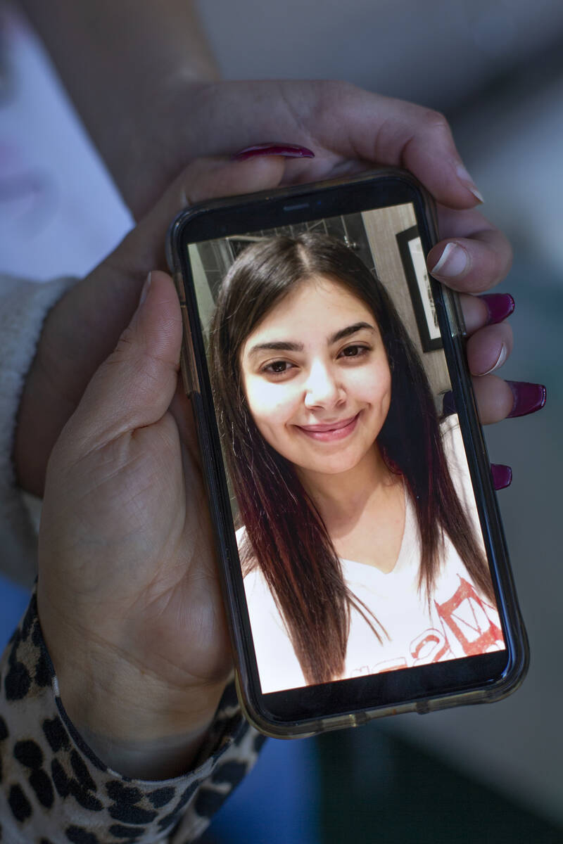 Jawaher Hejji's mother and two sisters Mariam Hejji and Rowda Hejji hold a photo of her at Mari ...