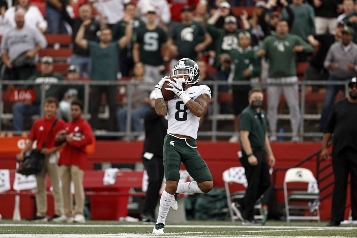 Michigan State wide receiver Jalen Nailor (8) on his way to score a touchdown against Rutgers d ...