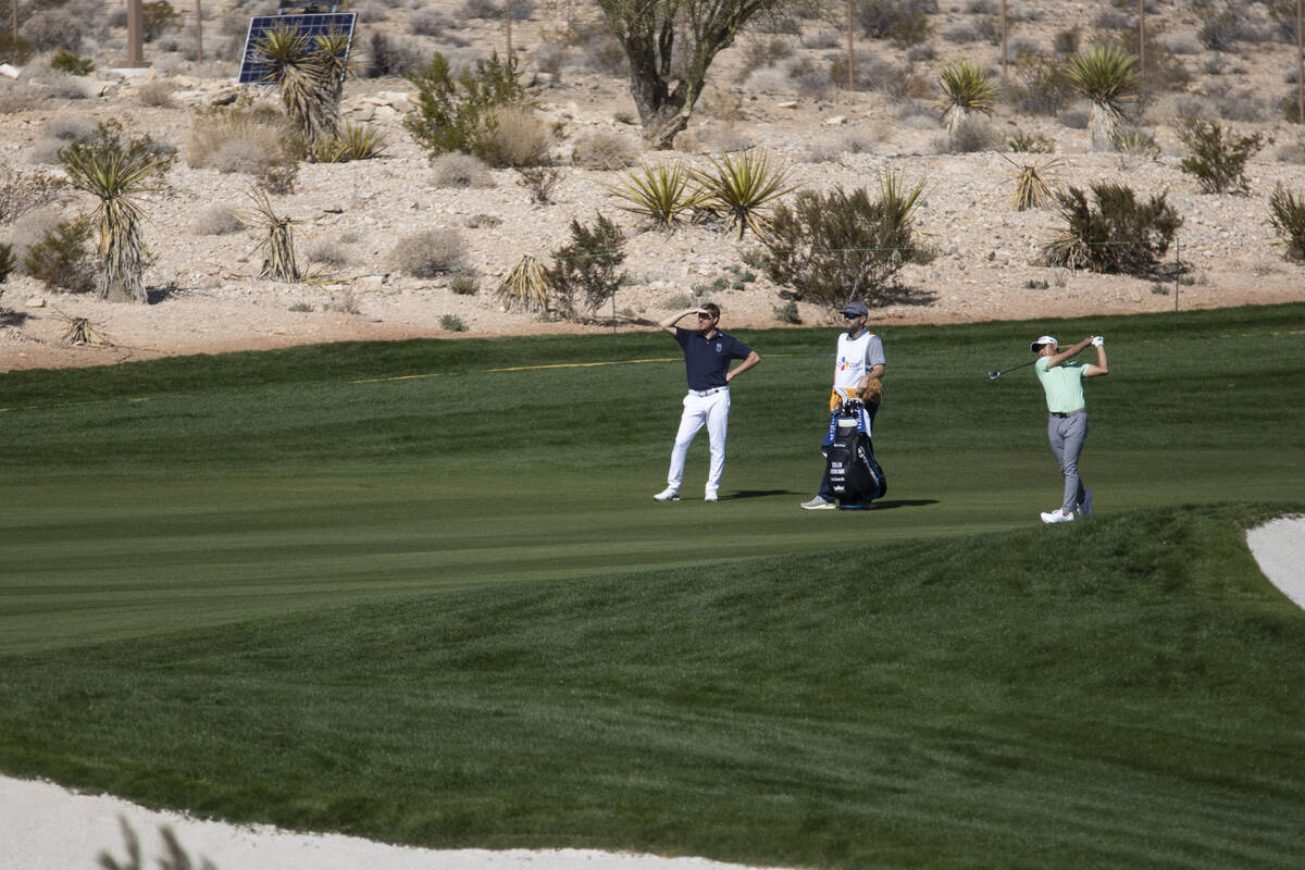 Collin Morikawa hits the ball from the fairway on the 18th hole during the CJ Cup Pro AM tourna ...