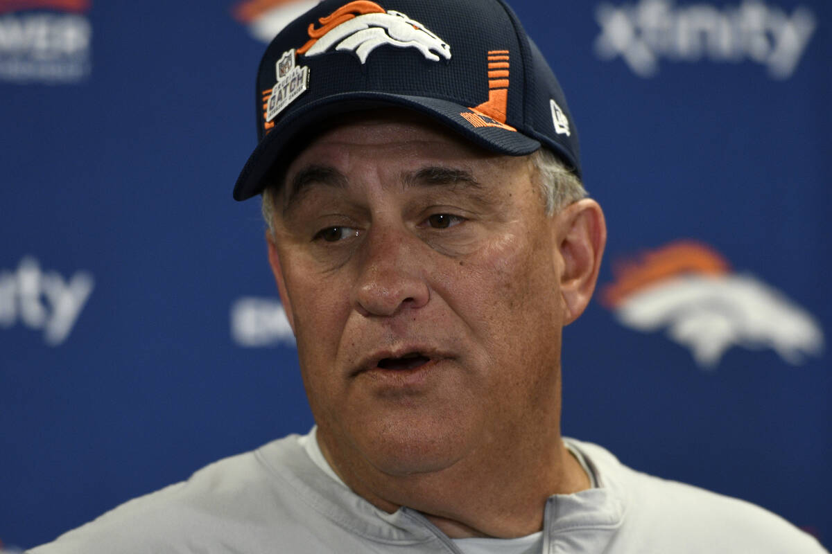 Denver Broncos head coach Vic Fangio meets with reporters following an NFL football game agains ...