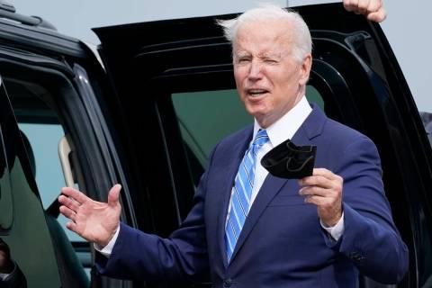 President Joe Biden responds to a question about the short term deal on debt as he arrives Air ...