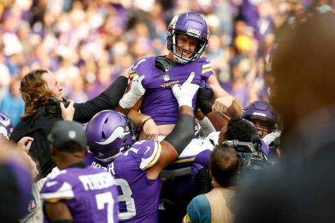 Minnesota Vikings kicker Greg Joseph (1) celebrates with teammates after kicking a 54-yard fiel ...