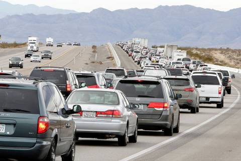 Traffic ibuilds on southbound Interstate 15 near Jean as holiday travelers leave Las Vegas, mos ...