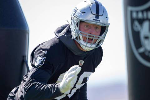 Raiders defensive end Maxx Crosby (98) runs through a drill during a practice session at the Ra ...