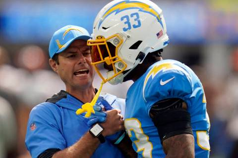 Los Angeles Chargers head coach Brandon Staley talks to free safety Derwin James (33) before an ...