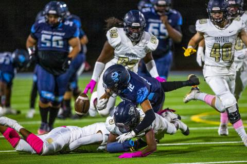 Canyon SpringsÕ Lackawanna Caston (12) fumbles the ball after a hard hit by FoothillÕs Amario ...