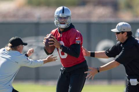 Raiders quarterback Marcus Mariota (8) works through a drill during a practice session at the R ...