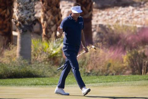 Keith Mitchell raises his hand after sinking a putt from on the 14th hole during the second rou ...