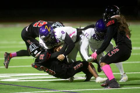 Durango running back Cole Marquez (9) and wide receiver Micah Reyes (17) are brought down by La ...