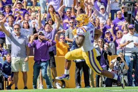 LSU running back Tyrion Davis-Price (3) runs for a touchdown in the first half of an NCAA colle ...