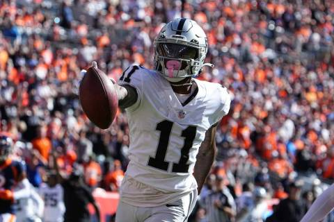 Las Vegas Raiders wide receiver Henry Ruggs III (11) scores a touchdown against the the Denver ...