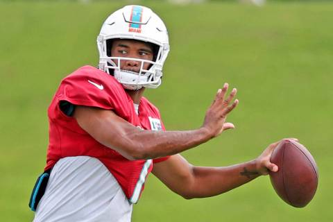 Miami Dolphins quarterback Tua Tagovailoa (1) sets up to pass during NFL football practice in M ...