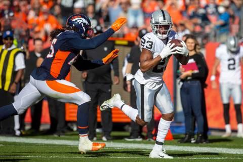 Raiders running back Kenyan Drake (23) runs past Denver Broncos inside linebacker A.J. Johnson ...