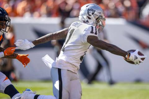 Raiders' wide receiver Henry Ruggs III (11) extends the ball over the goal line versus the Denv ...