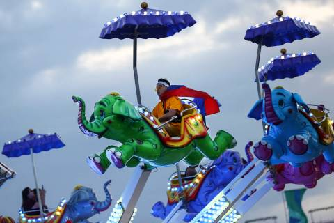 Phouvanh Sengchanh, of Anaheim, Calif., enjoys a carnival ride during the second day of the Ele ...