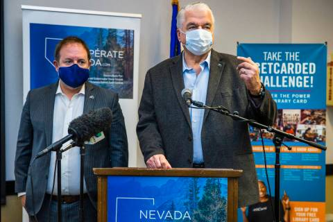 Governor Steve Sisolak, right, speaks beside Nevada Treasurer Zach Conine as they conclude the ...