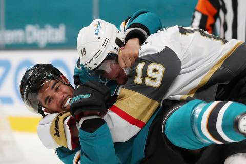 San Jose Sharks left wing Evander Kane (9), bottom, fights with Vegas Golden Knights right wing ...
