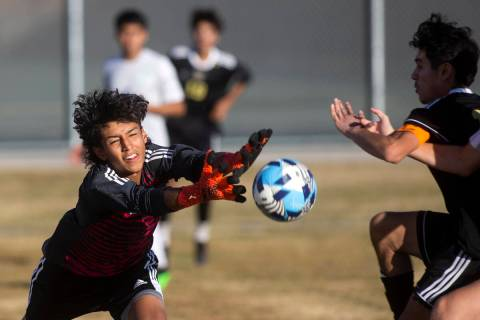 Green Valley's Edwin Lagunas-Monroy (0) misses the save on a goal shot by Sunrise Mountain's Kr ...
