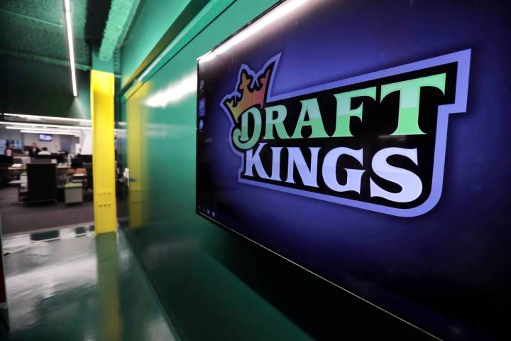 In this May 2, 2019, file photo, the DraftKings logo is displayed at the sports betting company ...