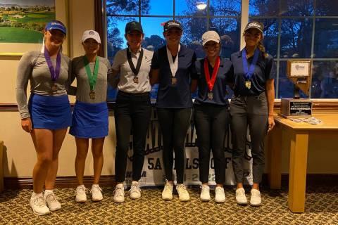 Coronado girls golf team members celebrate Tuesday after winning the Class 5A state championshi ...