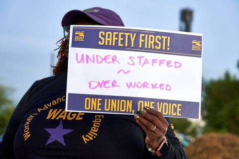 An employee with SEIU, Local 1107, protests unsafe working conditions in the Clark County Depar ...