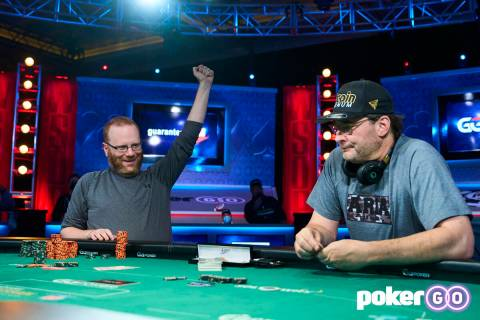 Adam Friedman, left, celebrates after showing his winning hand to defeat Phil Hellmuth in the $ ...