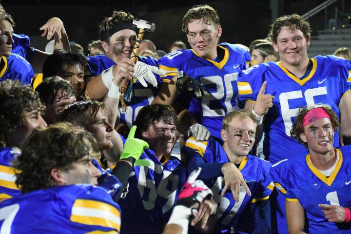 Moapa Valley seniors pose with the Hammer following a 46-28 victory over Virgin Valley on Frida ...